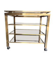 1970S GUY LEFEVRE STYLE GILT METAL BAR TROLLEY WITH FOUR SMOKE GLASS SHELVES