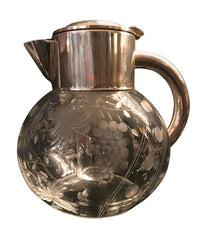 A BEAUTIFUL CUT GLASS COCKTAIL JUG WITH SILVER PLATE