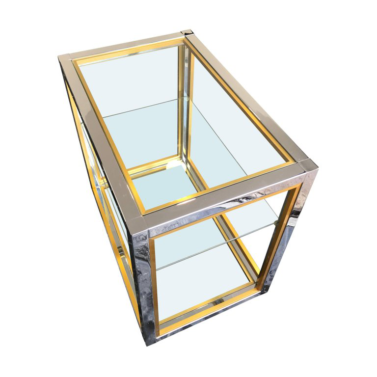 A CHROME AND BRASS BAR CART BY ZEVI
