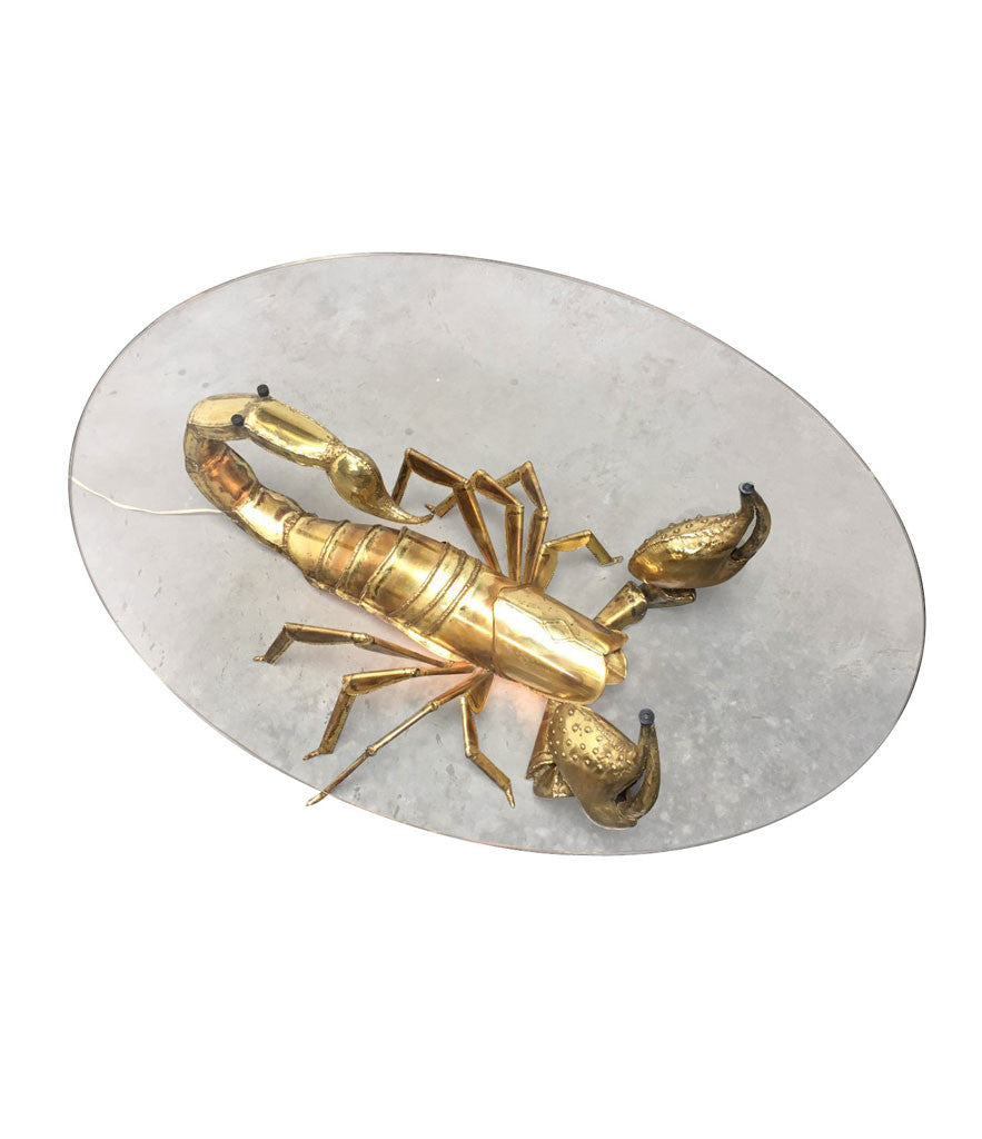 A DUVAL BRASSEUR SCORPION COFFEE TABLE