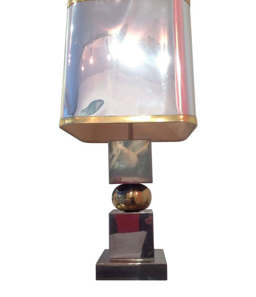 A FRENCH CHROME AND BRASS LAMP