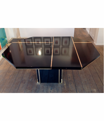 A BLACK MAHEY DINING TABLE