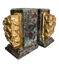 A PAIR OF ART DECO BOOKENDS OF AMAZONITE MARBLE AND CAST GILT METAL BEES