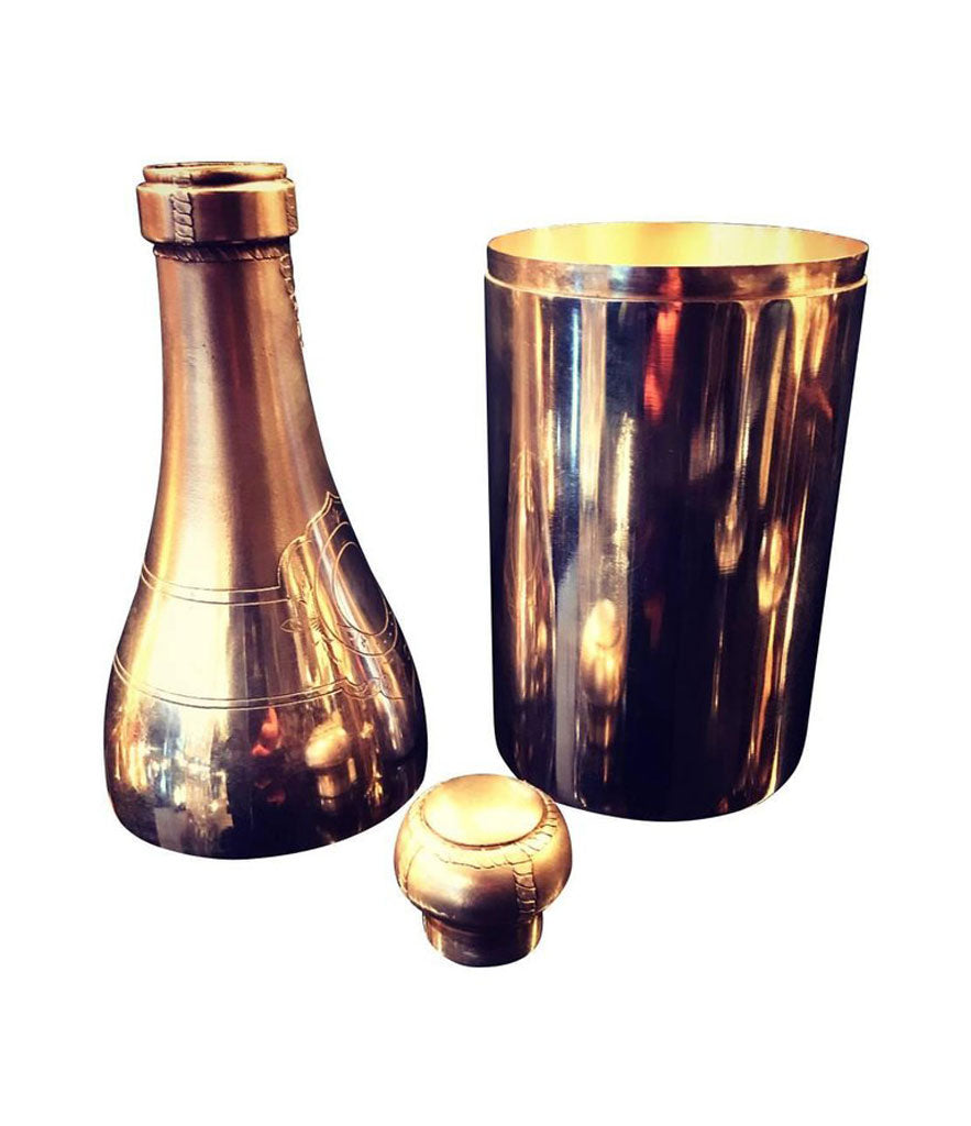A RARE SILVER PLATED CHAMPAGNE BOTTLE COCKTAIL SHAKER