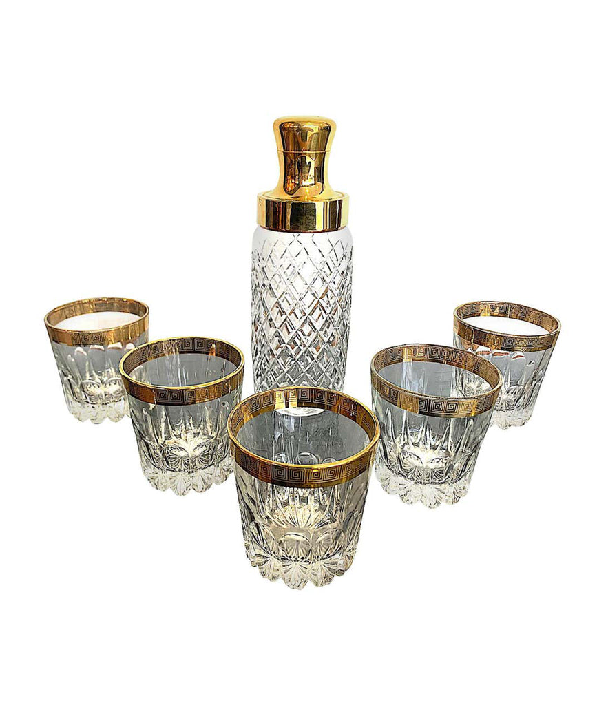CRYSTAL AND GILT COCKTAIL SET WITH SHAKER AND SIX MATCHING GILT EDGED TUMBLERS