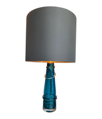PAIR OF ORREFORS TURQUOISE GLASS LAMPS WITH BRASS FITTINGS AND BESPOKE SHADES