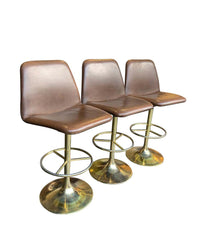 SET OF THREE 1970S SWIVEL BAR STOOLS BY JOHANSON DESIGN WITH GILT METAL BASES