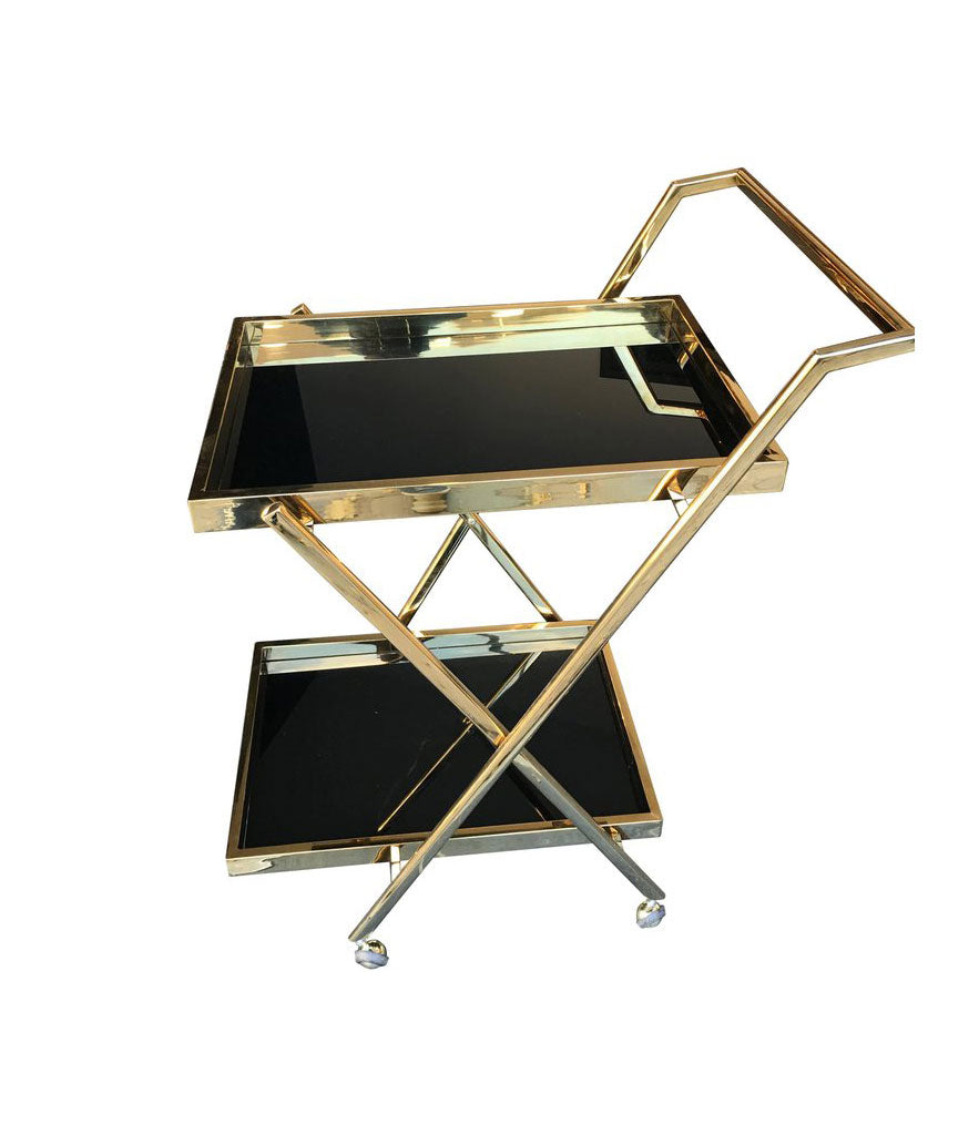 A BRASS BAR TROLLEY WITH BLACK GLASS SHELVES