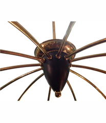 STILNOVO BRASS AND ENAMELLED METAL TWELVE-ARM SPIDER CHANDELIER