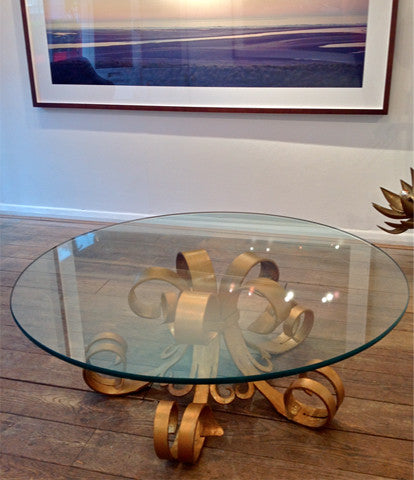 A GILT HOLLYWOOD COFFEE TABLE