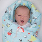 Yawning Baby in Blanket