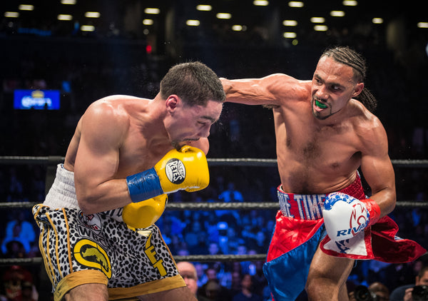 THURMAN DEFEATS GARCIA IN FRONT OF RECORD CROWD