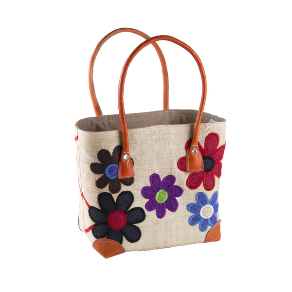Multi Coloured Small Daisy Rafia Basket neutral background bright coloured flowers