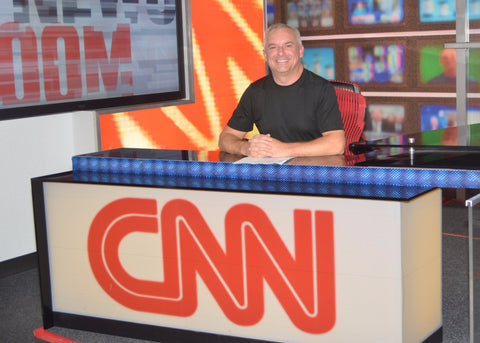 Tony Costa sitting at the desk at CNN headquarters in Atlanta, Georgia