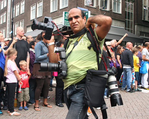news photographer working during a parade