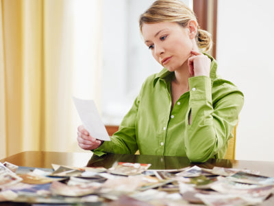 lady looking at pictures scattered on a table