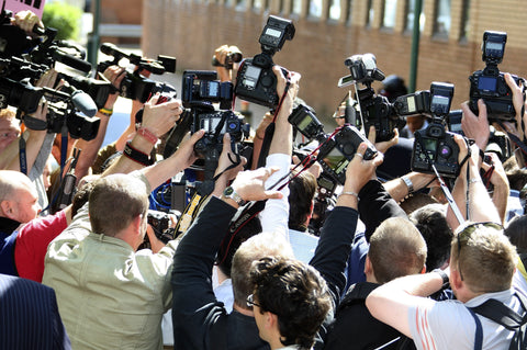 photographers trying to get the best picture during a media scrum