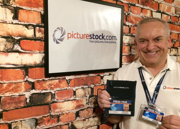 Tony Costa at Picture Stock offices showing their press pass