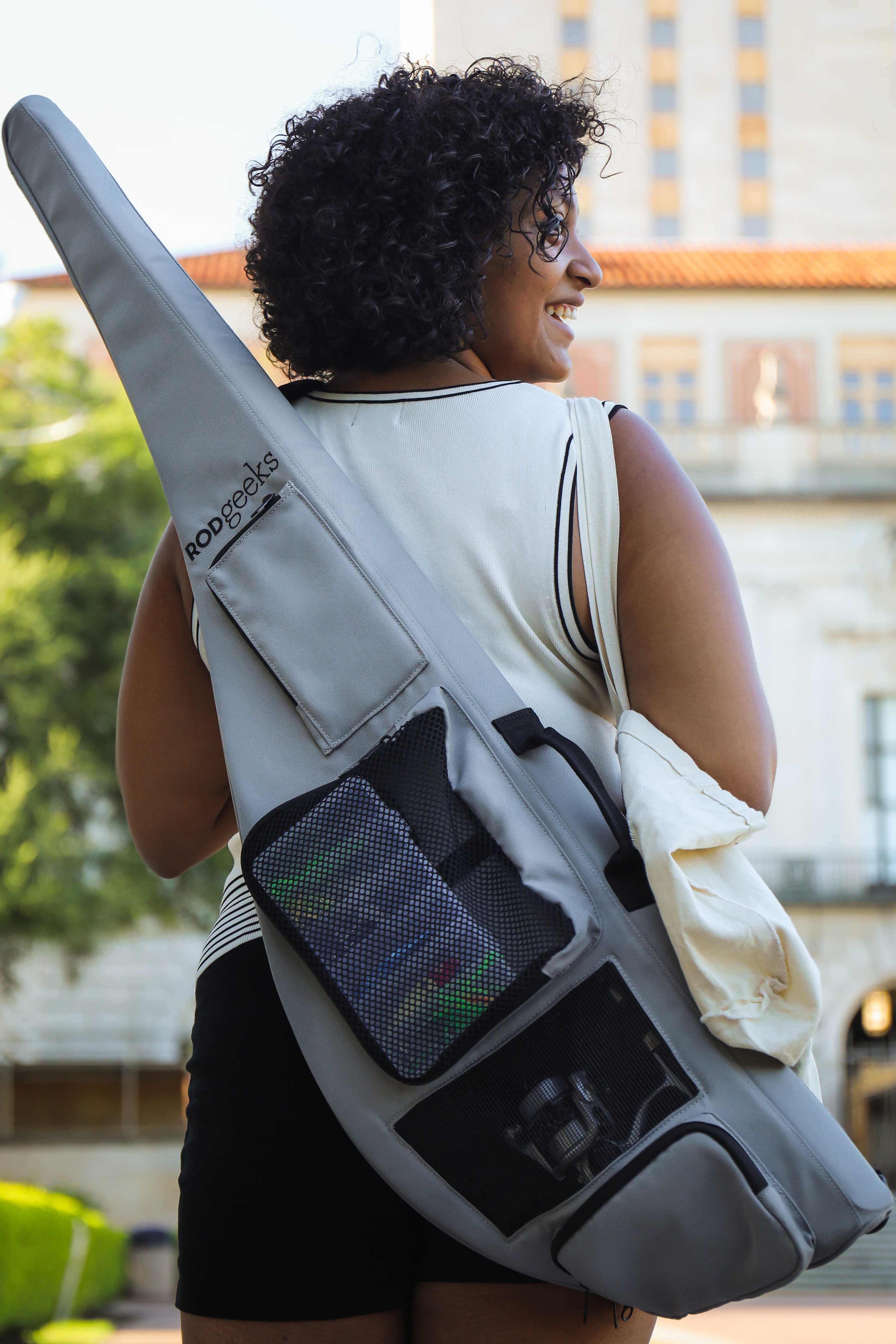 Woman carrying RG-42 travel fishing rod on her back