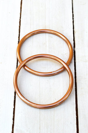 HAND BUFFED GOLD SLING RINGS