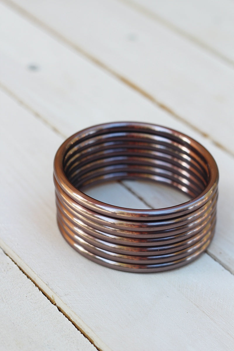 HAND BUFFED ROSE GOLD SLING RINGS
