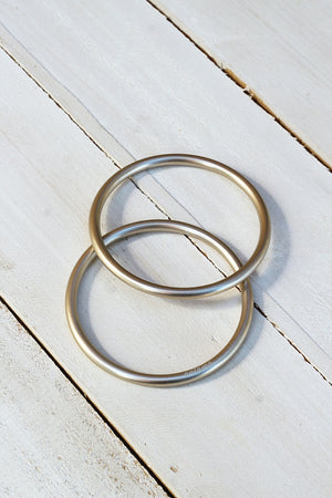 HAND BUFFED CHAMPAGNE SLING RINGS