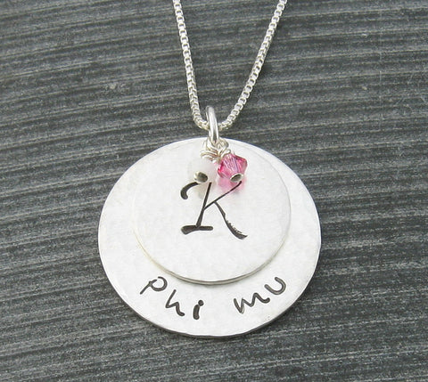 Phi Mu hand stamped sterling silver necklace with uppercase monogram and Swarovski crystals, gift wrapped.