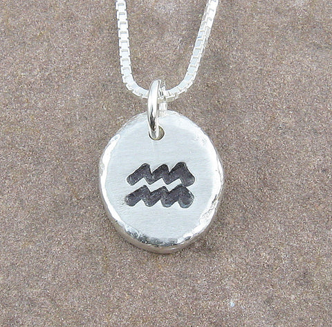 Aquarius necklace designed using recycled silver and a hydraulic press.