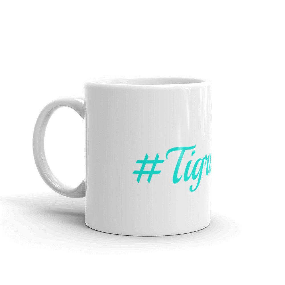 #TigrisFam White Mug with teal letters Like Ivory Ella and Makai Clothing Co.