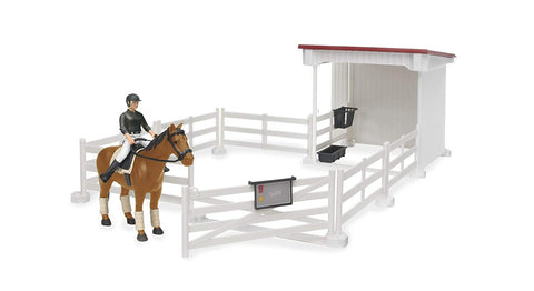 Small horse stable with horse and woman white