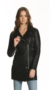 Image of a woman wearing the Vigoss black leather biker jacket with silver hardware