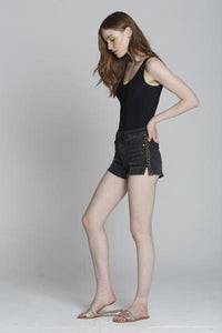 An image of a woman wearing the Ace High Rise animal print shorts from Vigoss