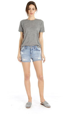 An image of a woman wearing the Ace High Rise light wash shorts from Vigoss.