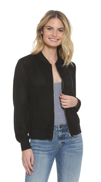 Image of a woman wearing the Vigoss ladies' suede jacket unzipped.