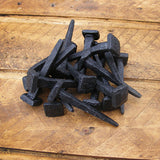 Handmade cut clasp nails in a forge blackened finish - ABC Ironmongery