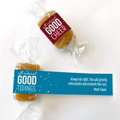 All-natural caramel holiday gift box wrapped in good tidings, good cheer