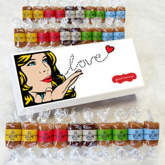 Pop art good karma gift box filled with gourmet caramel wrapped in quotes about life.