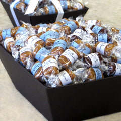 Good Karmal's Snowflake Caramel Gift Baskets - 30, 60, 90, 120 or 150 pieces of all-natural caramel wrapped in positive quotes.