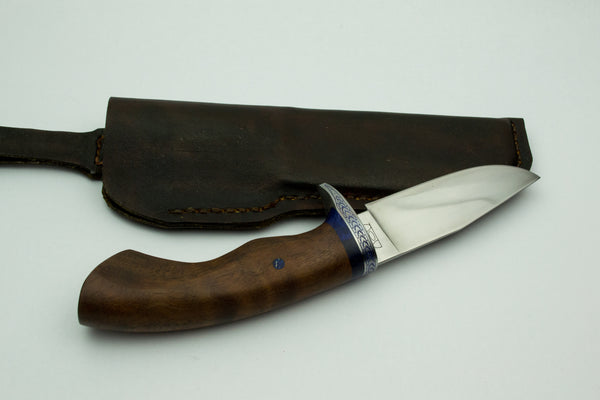 Small utility knife with wrought iron guard and walnut handle