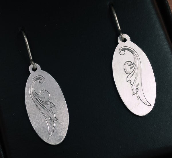 Hand-engraved titanium earrings by Podforge