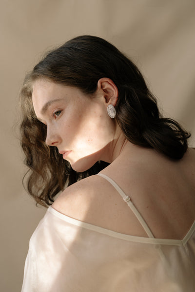 oval earrings on model