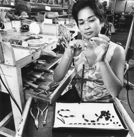 Maui Divers Jewelry Factor - Woman Stringing Pearls