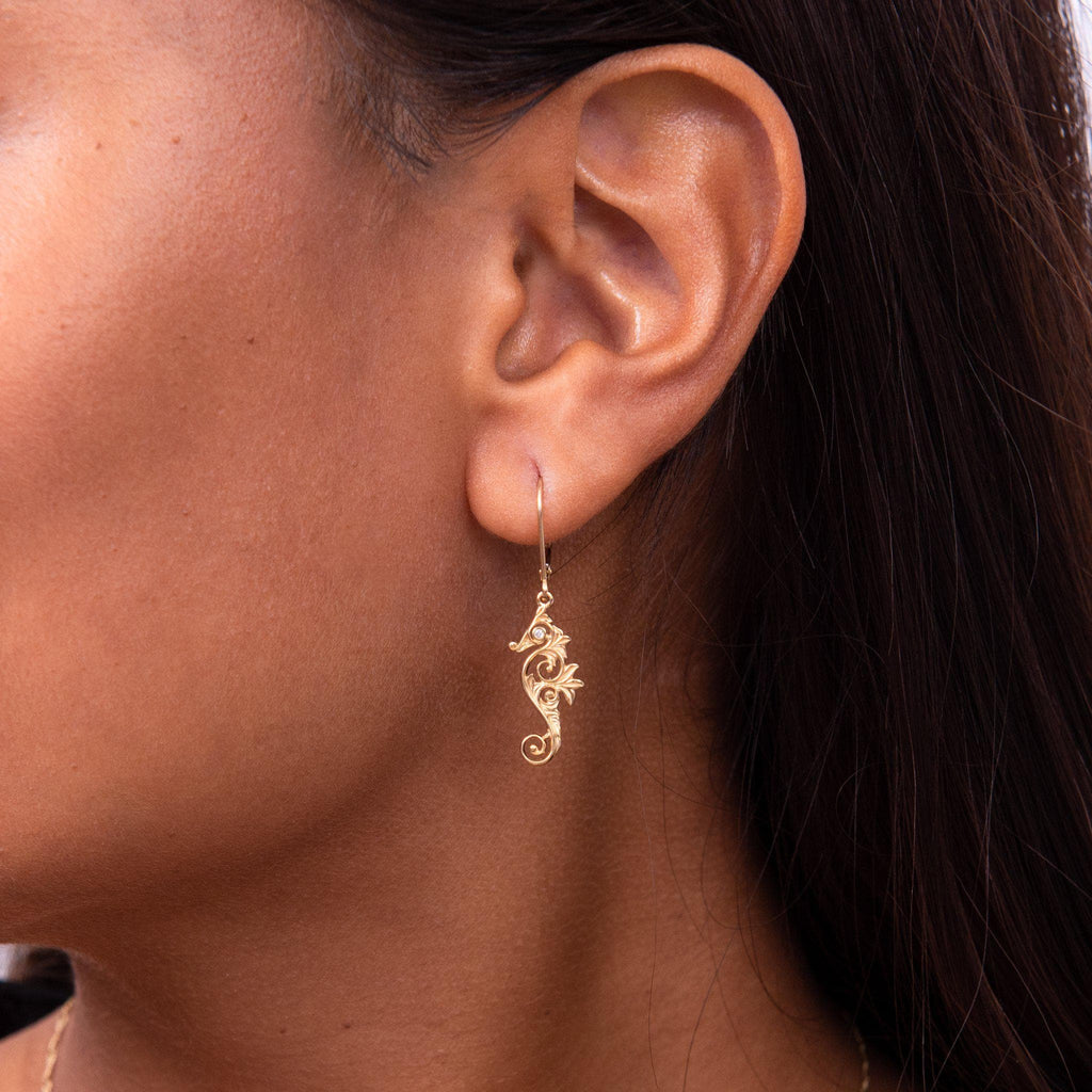 Living Heirloom Seahorse Earrings in 14K Yellow Gold with Diamonds on Model