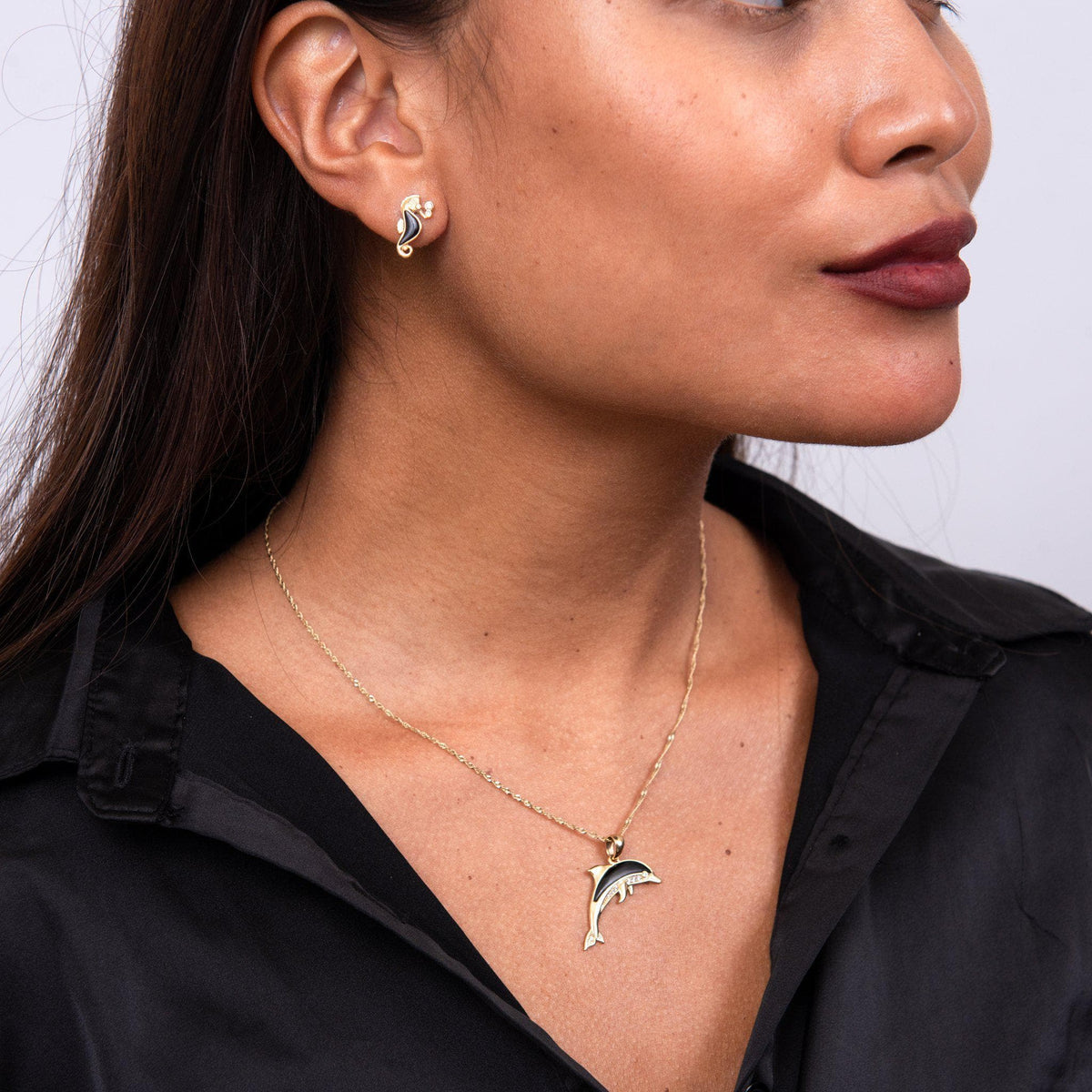 Sealife Dolphin Black Coral Pendant in Gold with Diamonds - 29mm on Model with Seahorse Earrings