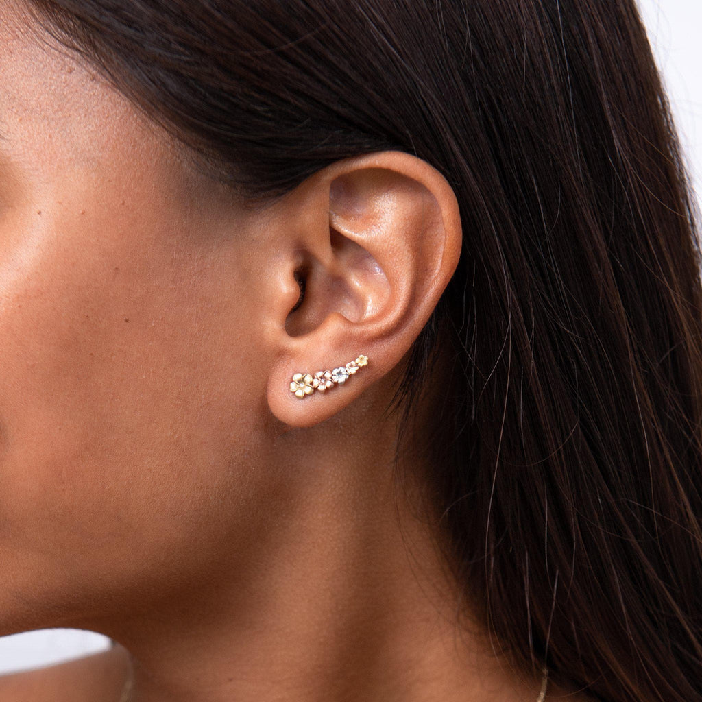 Plumeria Climber Earrings in 14K Tri-Color Gold With Diamonds on Model