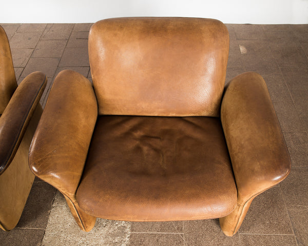 De Sede leather armchairs.