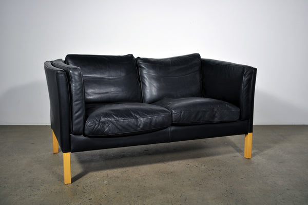 Stouby Black leather two seat sofa.