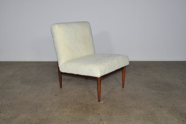Blackwood lounge chair with sheepskin.
