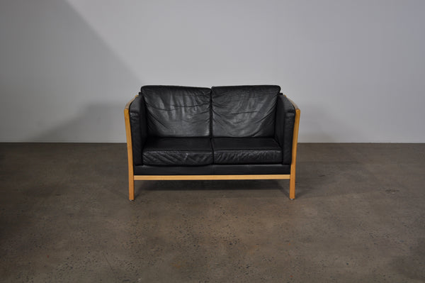 Danish two seat sofa with beech frame in black leather.