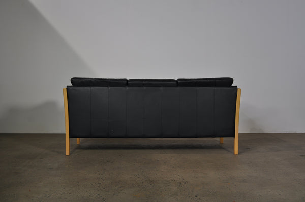 Danish three seat sofa with beech frame in black leather.